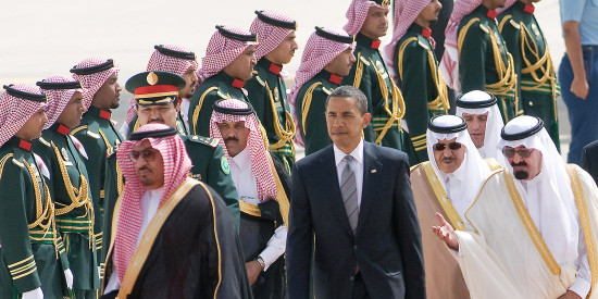 Saudi King Abdullah escorts U.S. President Barack Obama past an honor guard during an arrival ceremony in Riyadh on June 3, 2009.