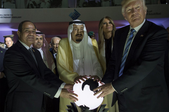 From left, Egyptian President Abdel Fattah el-Sisi, Saudi King Salman, U.S. first lady Melania Trump, and U.S. President Donald Trump put their hands on an illuminated globe during the inauguration ceremony of the Global Center for Combating Extremist Ideology in Riyadh, Saudi Arabia, on May 21, 2017.