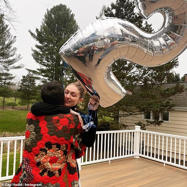 Baby bump:In photographs taken during the party - held at Yolanda's Pennsylvania ranch - Gigi sported a black turtleneck and attempted to conceal her burgeoning baby bump beneath a pair of high waisted jeans