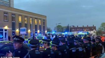 Police officers line up shoulder-to-shoulder in clear breach of the government