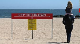 Covid-19 in the US: States and beaches reopen ahead of Memorial Day weekend