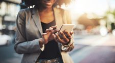 iStock photo of a businesswoman using a cellphone in the city.