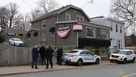 Investigators gather outside Nova Scotia clinic owned by the gunman who police said was responsible for a killing spree.