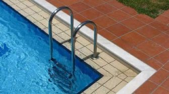 Coronavirus experts say it's safe to break out the bikini and use the pool while taking added precautions
