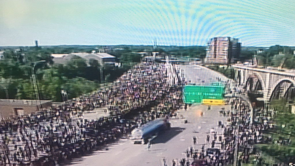 Truck drives through crowd on I-35W in Minneapolis, apparently hitting none. Driver mobbed, taken to hospital. – Twin Cities