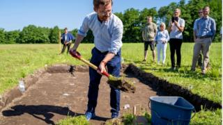 Norway's Minister of Climate and Environment Sveinung Rotevatn officially starts the excavation