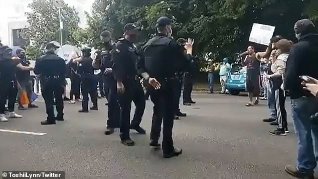 An officer with The Department of Oregon State Police was accused of making a white power hand gesture during a Black Lives Matter demonstration in Salem, Oregon