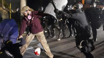 Riot declared in Portland after police union building set on fire