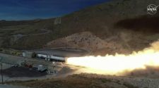 Moon booster rocket fired up in critical test