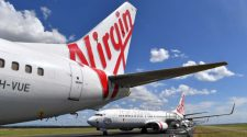 Virgin Australia pilot avoiding 'overspeed' led to crew member breaking leg, ATSB report finds