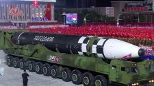 North Korea unveils massive new ballistic missile in military parade