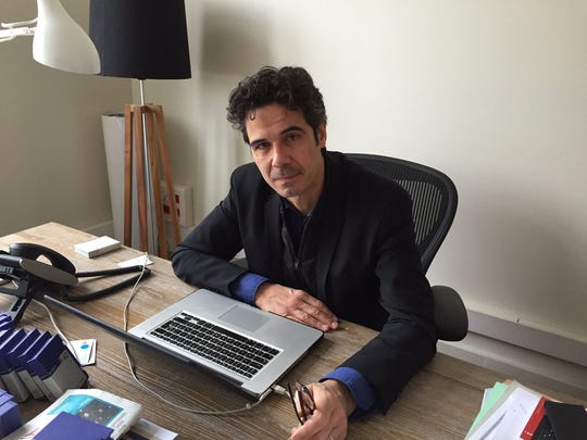 """Paul Moreira in his office in Paris on April 3, 2015. The documentary maker and journalist is the head of a company that shared a building with the satirical newspaper """"Charlie Hebdo."""" Moreira's staff were the first to respond to the incident that killed 12 people, including the newspaper's editor."""
