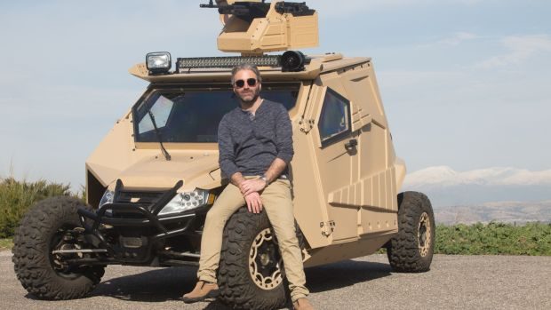 Nir Kahn, Plasan's design director, was keen to push the company further into road-car development and away from military products. Designer Nir Kahn with one of Plasan's military vehicles.