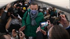 Alexey Navalny leaves Germany on Russia-bound jet five months after being poisoned