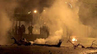 Tunisian police use tear gas to break up street protests
