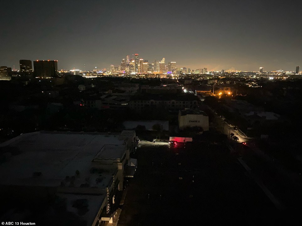 Houston, Texas: The deep freeze that has paralyzed Texas by knocking out its power grid and sparking an energy crisis saw 5 million homes plunged into darkness amid unprecedented rolling blackouts. Pictured above is homes in Houston without power but empty offices still lit up