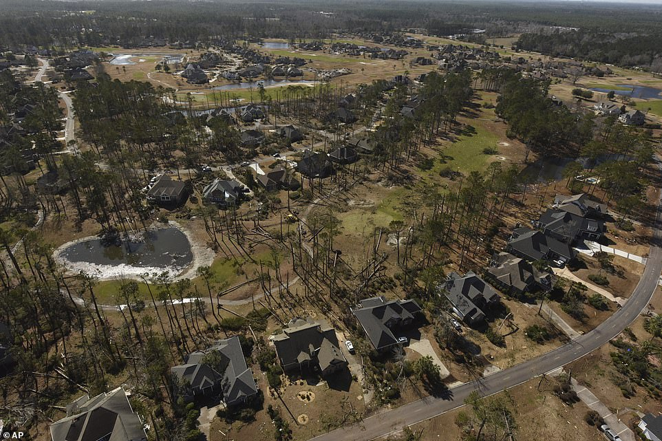 Aerial photos show ripped up trees and damaged roofs after the EF-3 tornado which ripped through North Carolina on Monday night