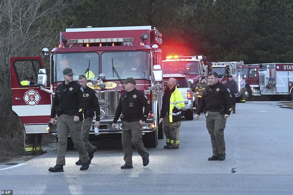 Emergency crews gather at a staging area near Sunset Beach, North Carolina on Tuesday after the deadly tornado