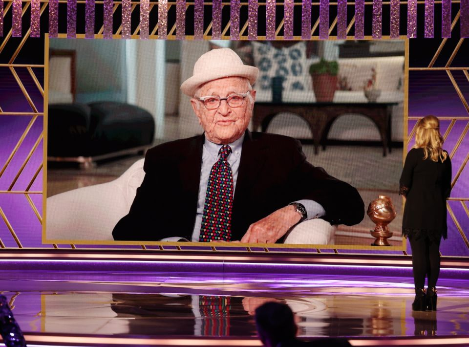 BEVERLY HILLS, CALIFORNIA: 78th Annual GOLDEN GLOBE AWARDS -- Pictured: (l-r) Honoree Norman Lear accepts the Carol Burnett Award while co-host Amy Poehler watches onstage at the 78th Annual Golden Globe Awards held at The Beverly Hilton and broadcast on February 28, 2021 in Beverly Hills, California. -- (Photo by Christopher Polk/NBC/NBCU Photo Bank via Getty Images)