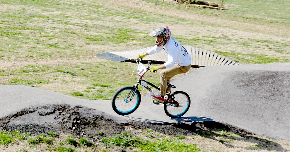 Marc Hayot/Herald-Leader Cyclist James Stevenson shows some tricks on his bike on the concrete track at City Lake Park. Stevenson usually rides at Mudtown BMX in Lowell, but when he heard Siloam Springs had a concrete track with the twists and turns he said he had to come and try it out.