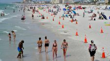 Cities brace for spring break crowds as health officials urge caution