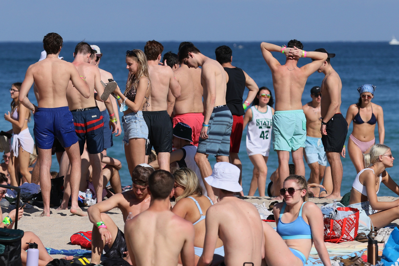 Americans take spring break vacations despite experts' concerns it will fuel virus spread
