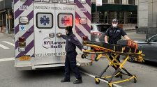 Paramedics were on the scene after a court officer shot him dead on Monday afternoon