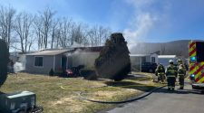 Fire crews respond to a working structure fire on Maple Ave. in Elmira