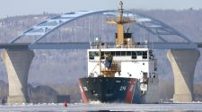 The U.S. Coast Guard Cutter Alder breaks what little ice was left on the St. Louis River downstream of the Bong Bridge in March 2020. (Steve Kuchera / File / News Tribune)