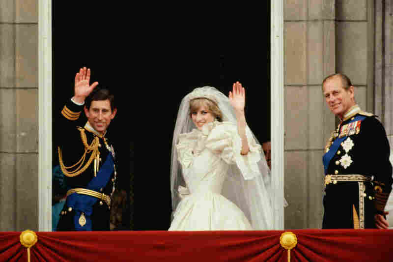 Philip (right) accompanies Prince Charles and Princess Diana on the balcony of Buckingham Palace after their wedding on July 29, 1981.