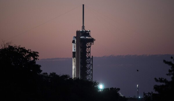 The SpaceX Falcon 9 rocket and Crew Dragon capsule at Kennedy Space Center in Florida on Thursday ahead of the spacecraft's launch.