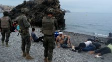 Spanish troops deploy in Ceuta after thousands break in from Morocco